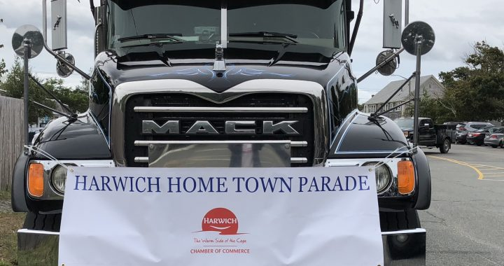 Front view of Mack truck with Harwich Hometown Parade banner